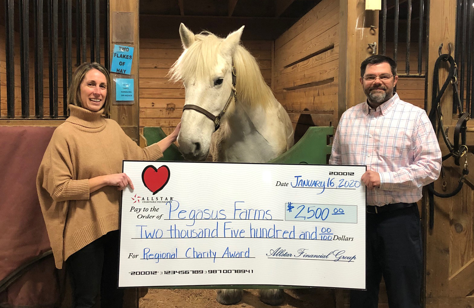 check presentation to Pegasus Farm representative